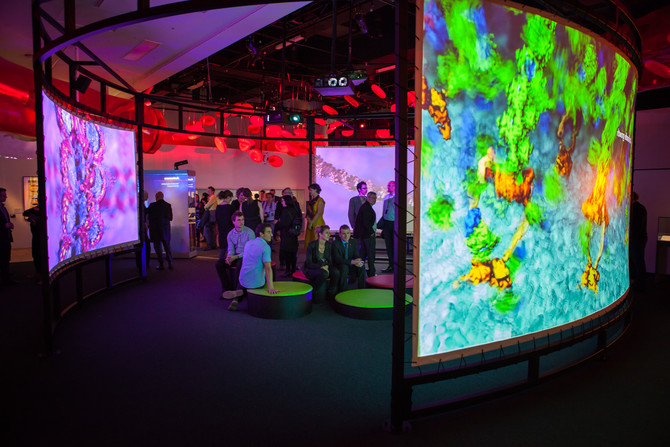 People watching projections in the BioMedical Breakthroughs exhibition during the stakeholder launch
